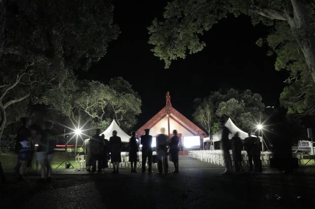 Preparation for the dawn ceremony, upper marae, Waitangi. Photo / Michael Craig