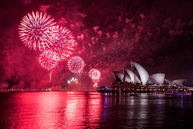 The Sydney Opera House is lit up during New Year's Eve celebrations. Photo / AP
