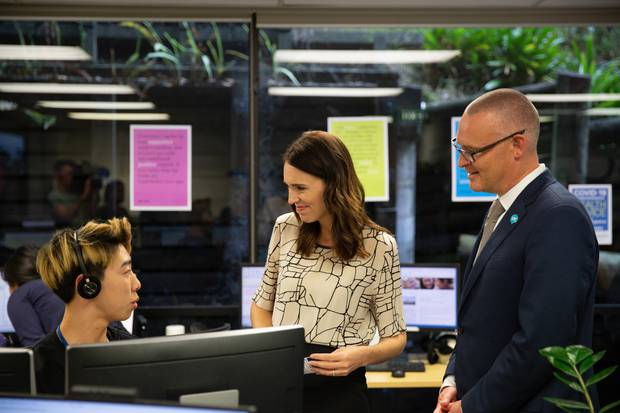 Prime Minister Jacinda Ardern and Health Minister David Clark meet with staff at the Healthline office in Grafton, Auckland, the day after a first case of coronavirus was confirmed in New Zealand.