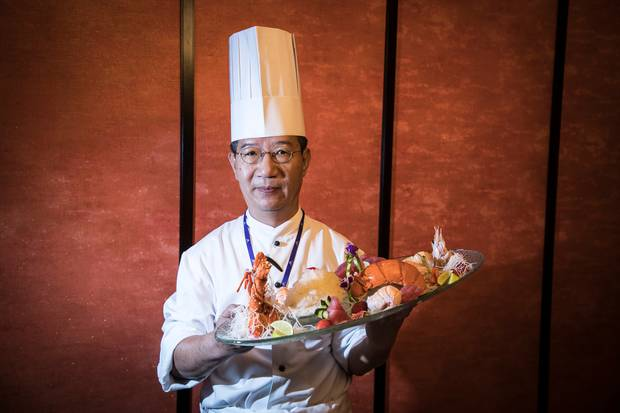 Chef Raymond Xue with a dish from SkyCity's $18,000 Chinese dinner menu. Photo / Michael Craig
