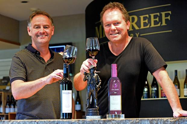 Senior winemaker Paul Dawick (left) and chief winemaker Tim Preston toast Mills Reef Winery's award at the Royal Easter Show Wine Awards. Photo / George Novak