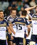 Sam Carter of the Brumbies and team mates look dejected. Photo / Getty