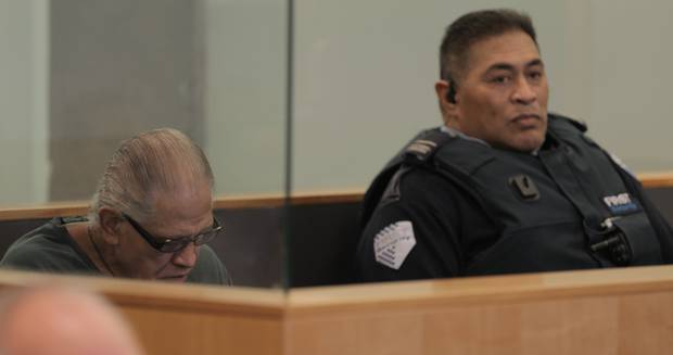 Malcolm Rewa sits in the dock in the High Court at Auckland. Photo / Michael Craig