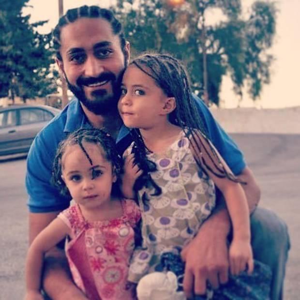 Wasseim Alsati, with his daughters, including Alin (left).