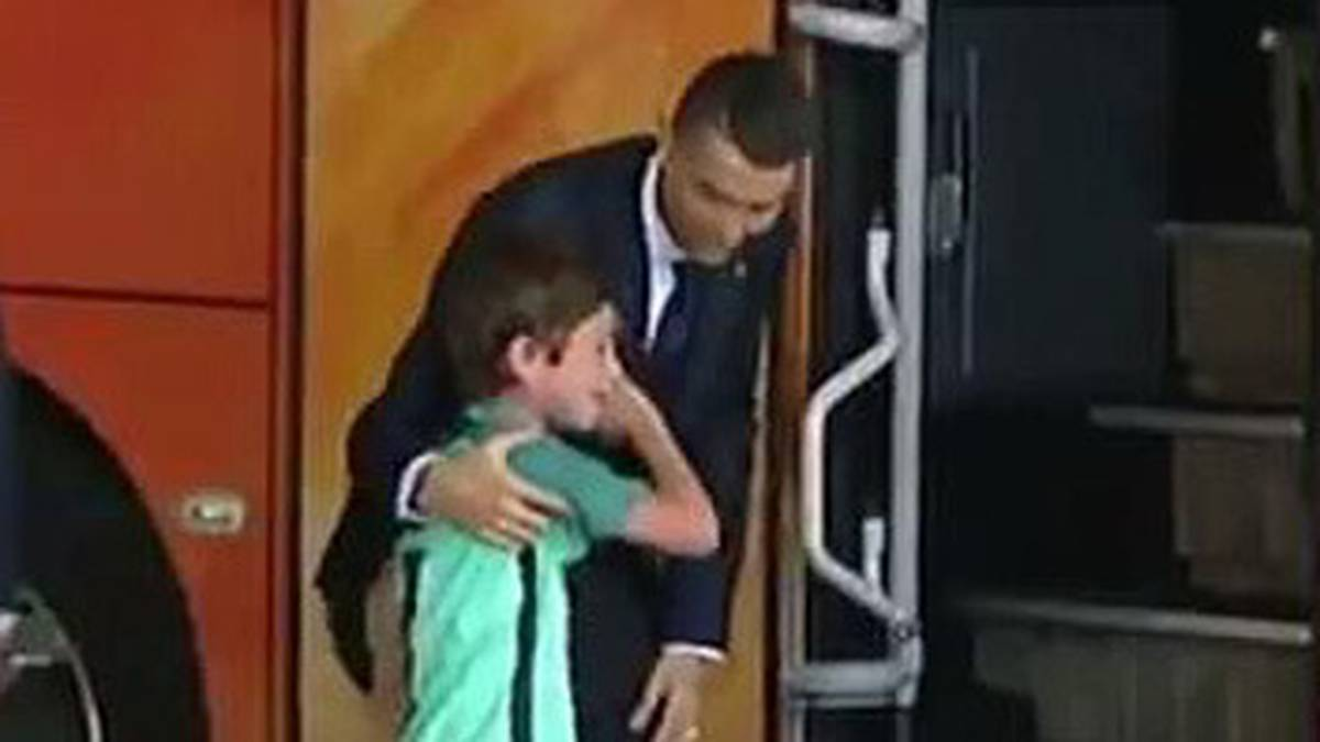 football-heartwarming-moment-star-striker-cristiano-ronaldo-hops-off-team-bus-to-comfort-crying-young-fan