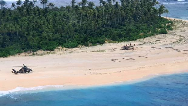 An Australian Army helicopter lands on Pikelot Island in the Federated States of Micronesia, where three men were found safe and healthy after being missing for three days. Photo / AP