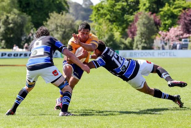 North Otago centre Lemi Masoe takes on Wanganui captain Campbell Hart and second-five Penijamini Nabainivalu.