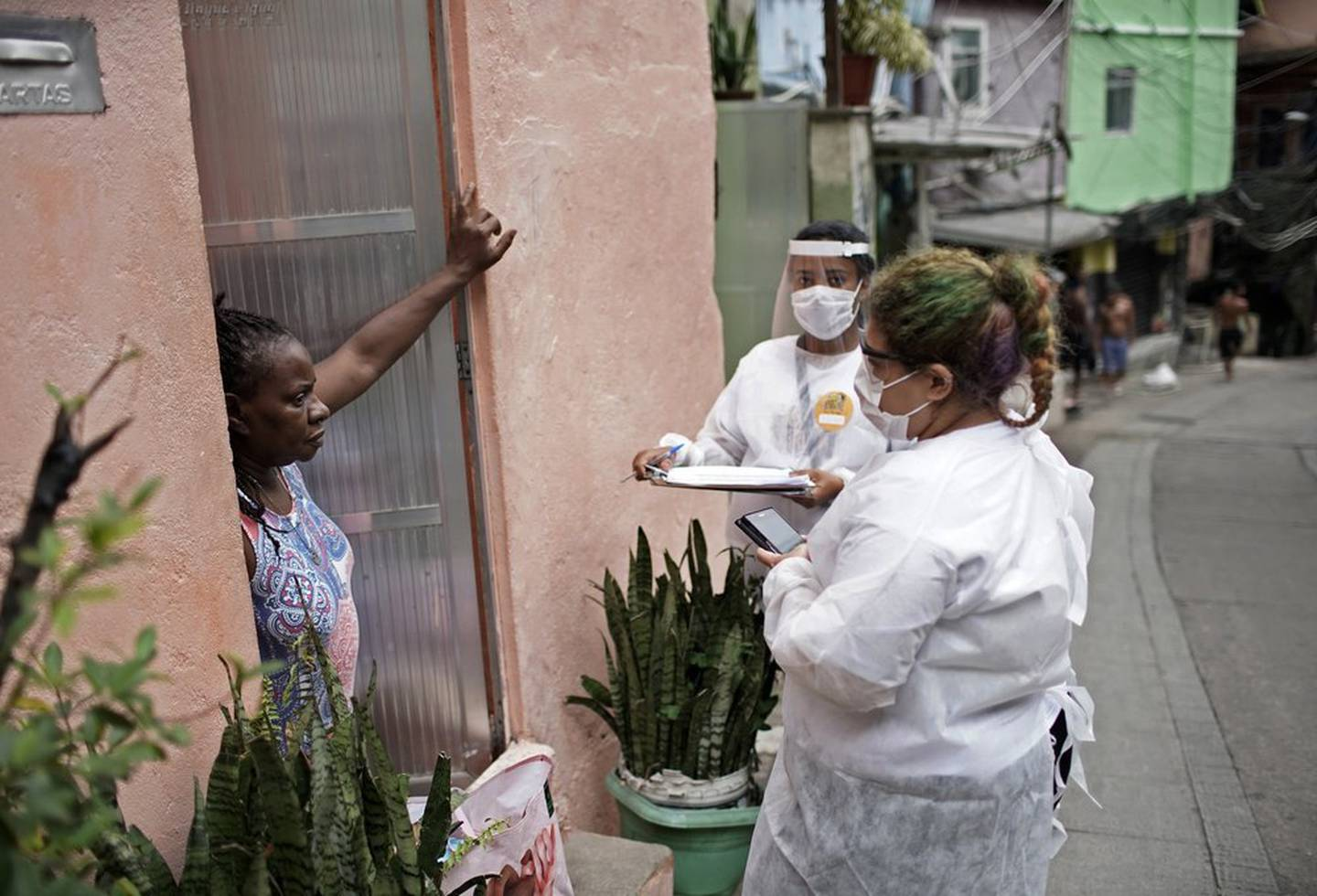 Health workers organise Covid-19 tests with residents in the Rocinha slum. Photo / AP