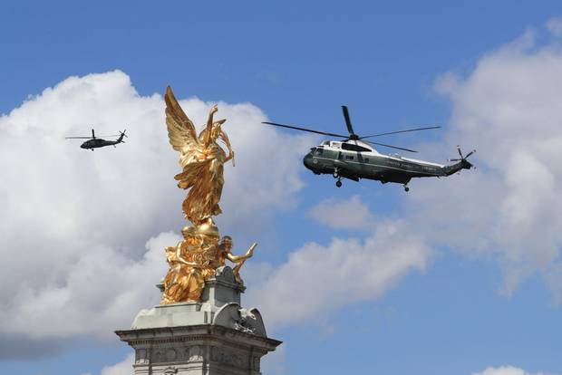 US presidential helicopters pass the Queen Victoria Memorial outside Buckingham Palace in London, as President Donald Trump arrives to meet Queen Elizabeth II. Photo / Getty Images