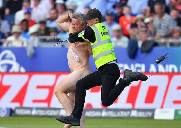 A streaker is tackled by a security guard at the Cricket World Cup match between the Black Caps and England. Photo /Getty