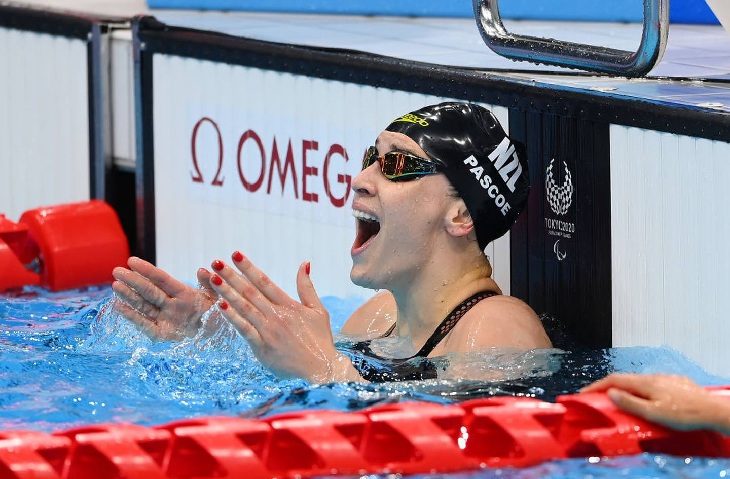 Sophie Pascoe reacts after winning gold in the S9 100m freestyle. Photo / Getty