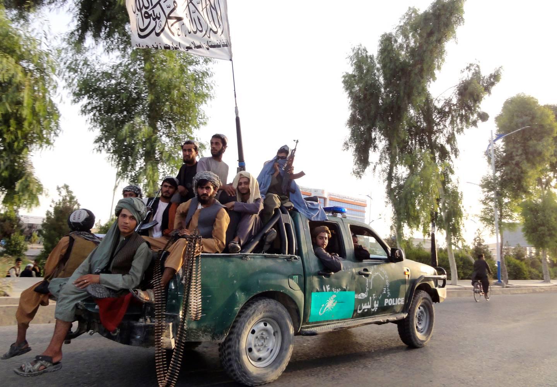 Taliban fighters patrol inside the city of Kandahar, southwest Afghanistan. Photo / AP