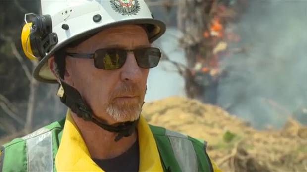 Deputy principal fire officer for the Nelson Tasman district, Robin Thompson (left), and his crews are working on creating 50m fire breaks to contain the flames.