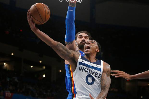 Minnesota Timberwolves guard Jeff Teague goes up for a shot in front of Oklahoma City Thunder centre Steven Adams. Photo / AP