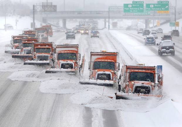 As a winter storm system moves through the upper Midwest, snow plows clear snow from the westbound lanes of US Highway 12/18 in Madison, Wisconsin. Photo / AP
