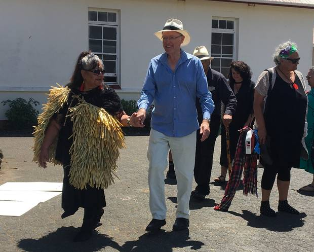Dr Don Brash is escorted to lunch at Ti Tii Marae. Photo / David Fisher