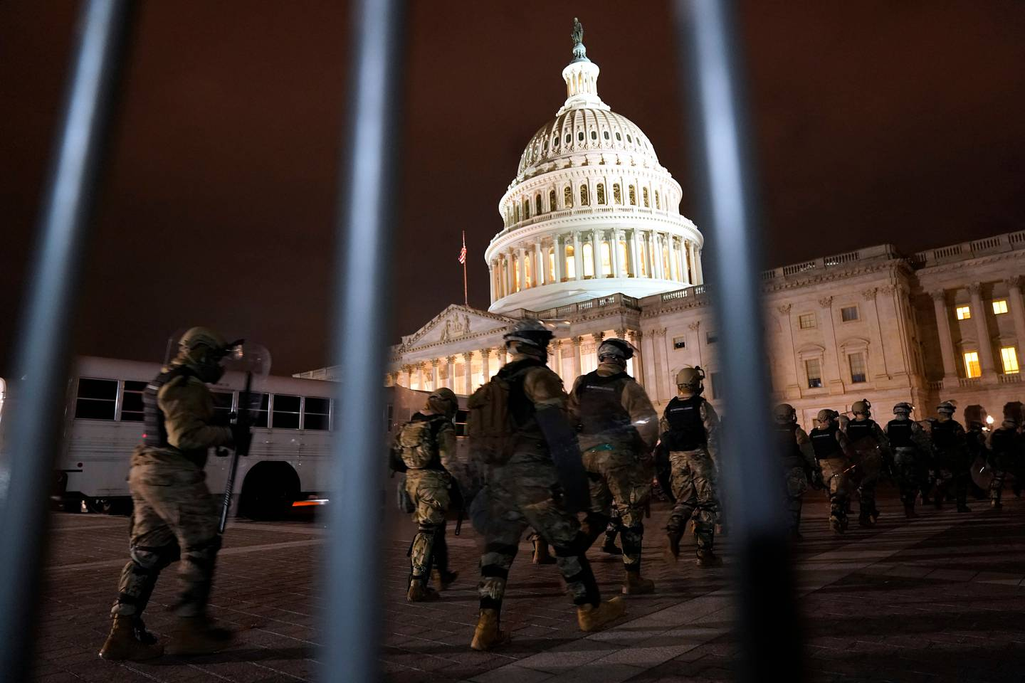 Members of the National Guard arrive to secure the area outside the US Capitol. Photo / AP