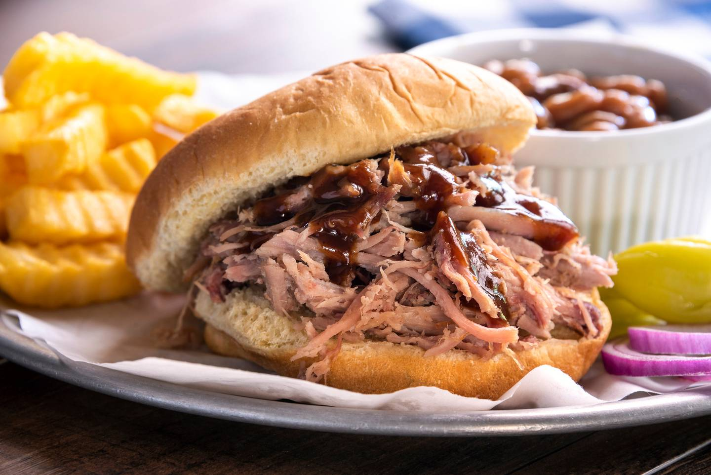 This easy pulled pork is the ideal filling for tacos or sliders for dinner. Photo / Getty Images