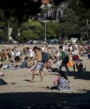 Thousands flock to Mission Bay to enjoy the summer. Photo / Dean Purcell