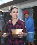 Prime MInister Jacinda Ardern with partner Clarke Gayford painting their fence. Photo / Doug Sherring