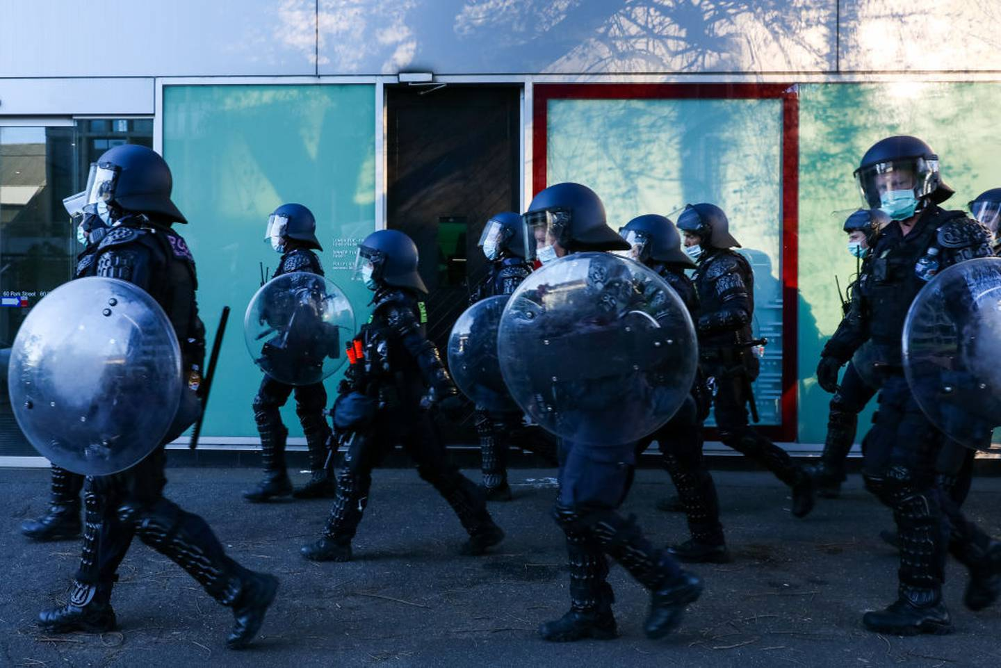 Riot police are seen running towards protestors at the Shrine of Remembrance on September 22, 2021 in Melbourne. Photo / Getty Images