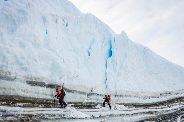 Two scientists scout Antarctica's Taylor Glacier for a potential ice core sampling site. Photo / Supplied