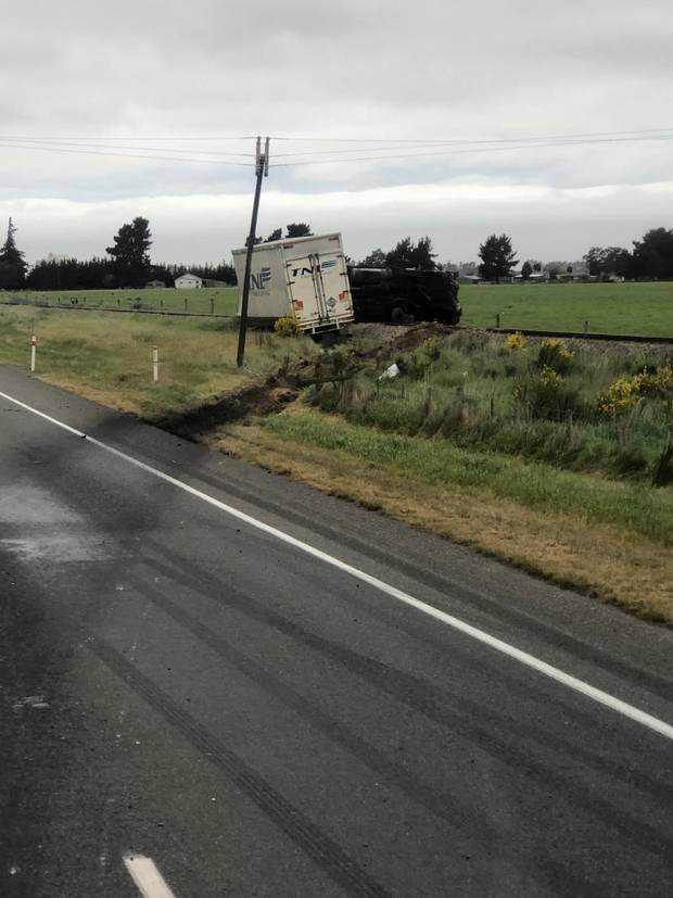 The truck involved in the serious crash on State Highway 1 near Rakaia ended up off the road and near railway line. Photo / Bridget Shimmin