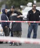 Family and friends grieve at the scene in Manurewa where Leslie Putt died. Photo / Brett Phibbs