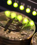 Businesses consider paying off cyber criminals in Bitcoin as a way to avoid reputation damage. Photo/File.