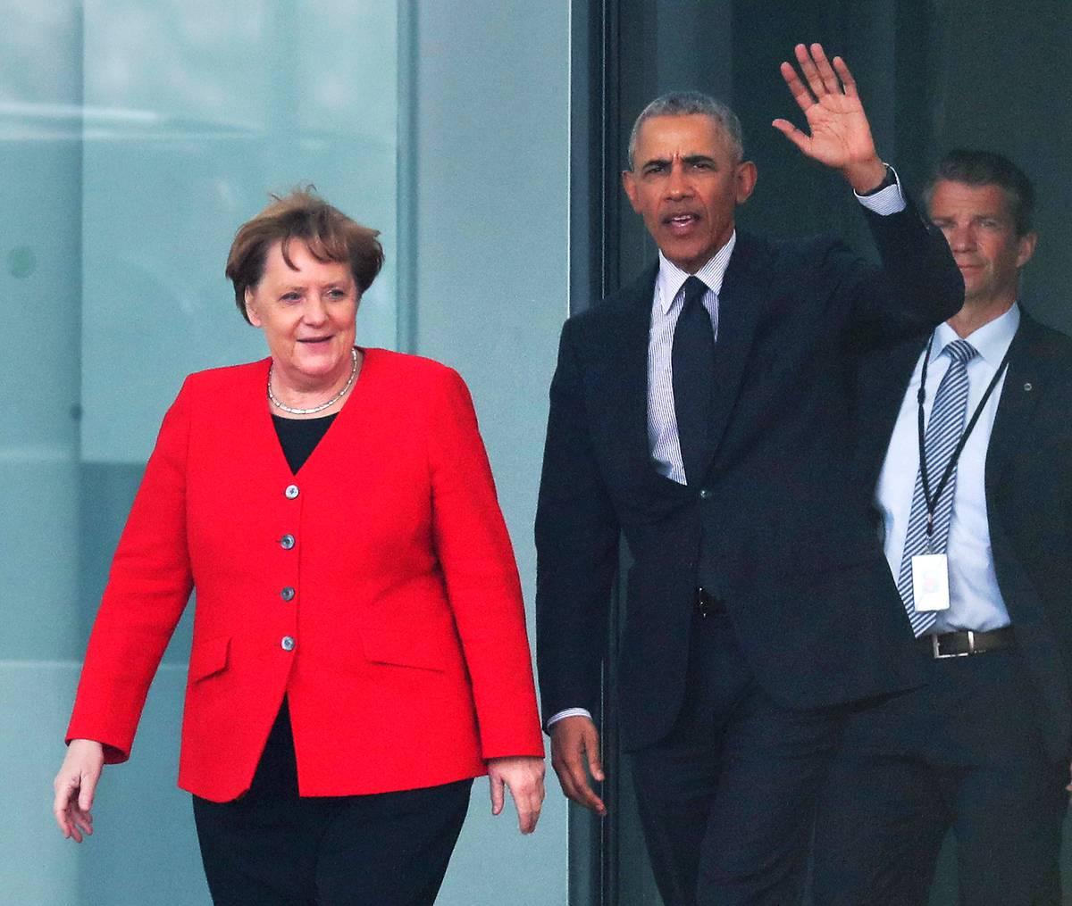 Trump who? Angela Merkel gives Barack Obama a very warm welcome