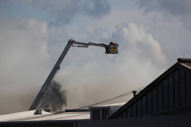 Fire crew at the scene of the industrial fire. Photo / Dean Purcell