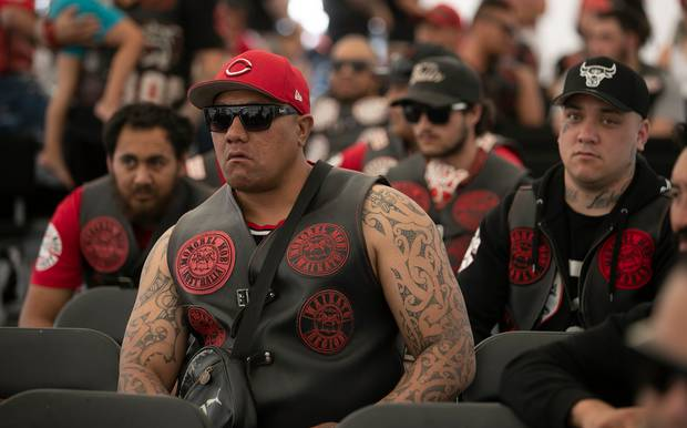 Members of the Waikato Mongrel Mob Kingdom Chapter listen to various speakers. Photo / Alan Gibson