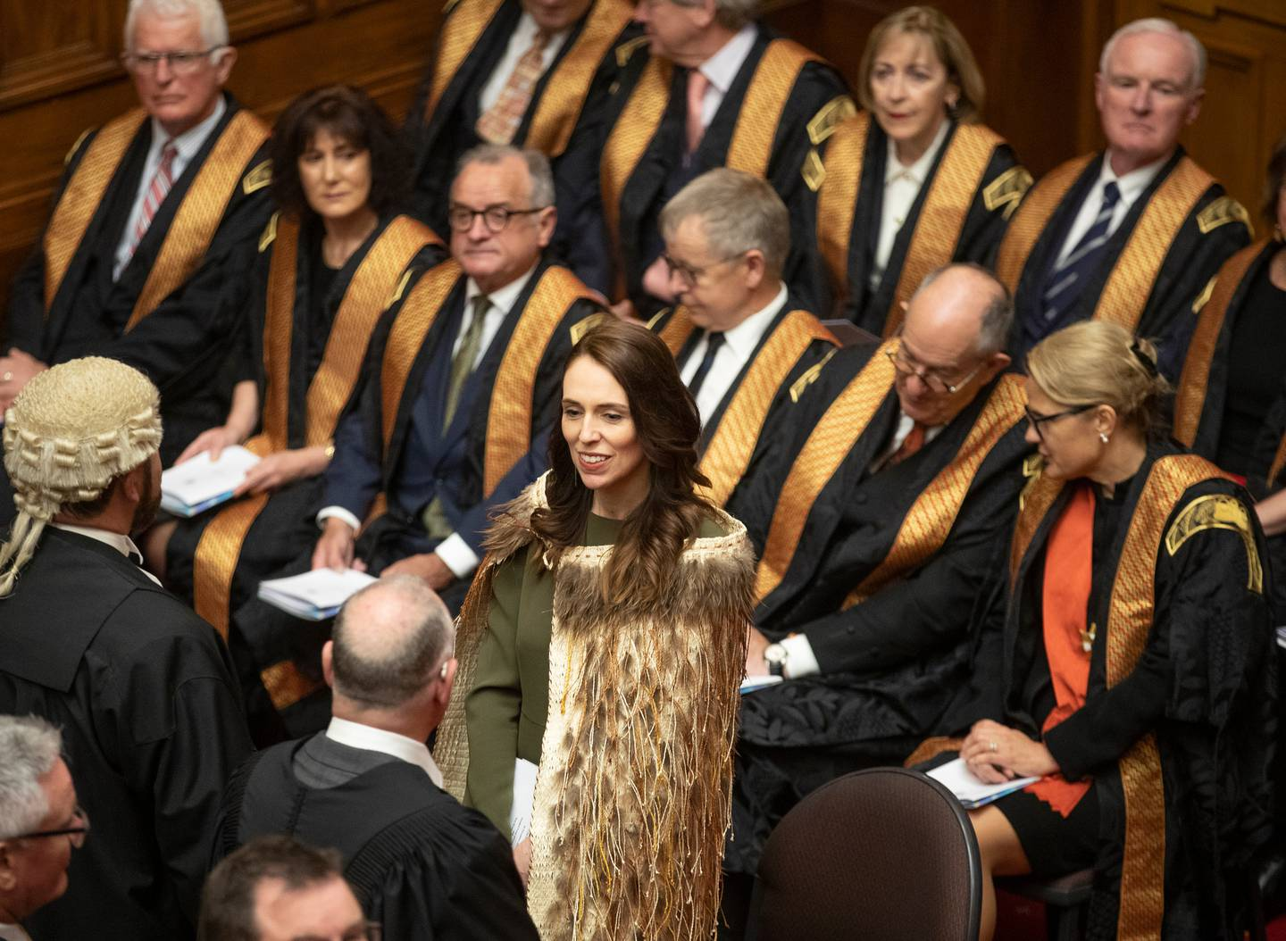 Prime Minister Jacinda Ardern standing in front of members of the judiciary as MPs enter the Legislative Council Chamber during the State Opening of Parliament. Photo / Mark Mitchell
