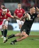 All Blacks player Israel Dagg evades Liam Williams of the Lions. Photo / Alan Gibson