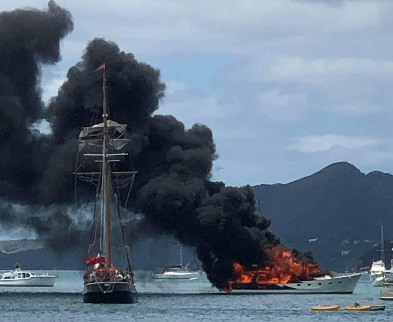 The boat caught fire off Moturura Island yesterday and was engulfed in minutes. Photo / Whangaruru Volunteer Coastguard