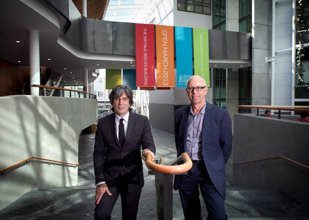 AUT head Derek McCormack, pictured (left) with architect Richard Harris in the new Sir Paul Reeves Building in 2013, wants all AUT students to start the year again from scratch. Photo / File
