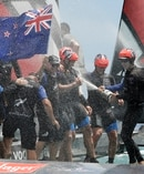 The crew of Emirates Team New Zealand spray champagne as they celebrate after defeating Oracle Team USA to win the America's Cup. Photo / AP