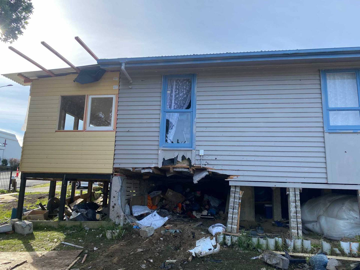 Two people died after a car crashed into a house on Warspite Ave in Porirua. Photo / Nick James
