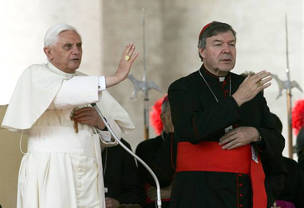 Pope Benedict XVI, left, and Cardinal George Pell bless the faithful in St. Peter's square at the Vatican in 2005. Photo / AP