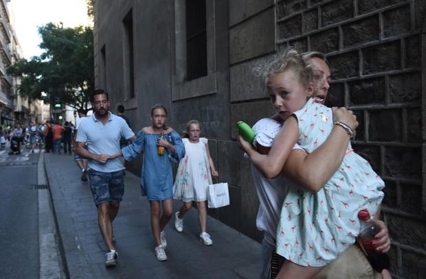 People flee the scene in Barcelona in Barcelona. Photo / AP