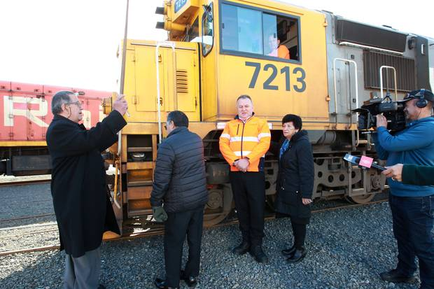 Haami Hilton, kaumatua, blessing a work train in anticipation of the railway line reopening. Third from left is Shane Jones, regional economic development minister.