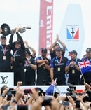 Peter Burling (left) and Glenn Ashby of Emirates Team New Zealand lift the America's Cup trophy after they beat Oracle Team USA. Photo / Getty