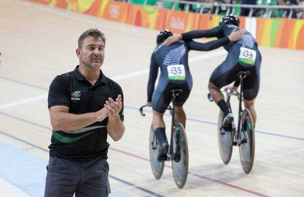 New Zealandcoach Anthony Peden congratulates Ethan Mitchell, Eddie Dawkins and Sam Webster on silver in the mens sprint at Rio Olympics Games 2016. Photo / Photosport.co.nz