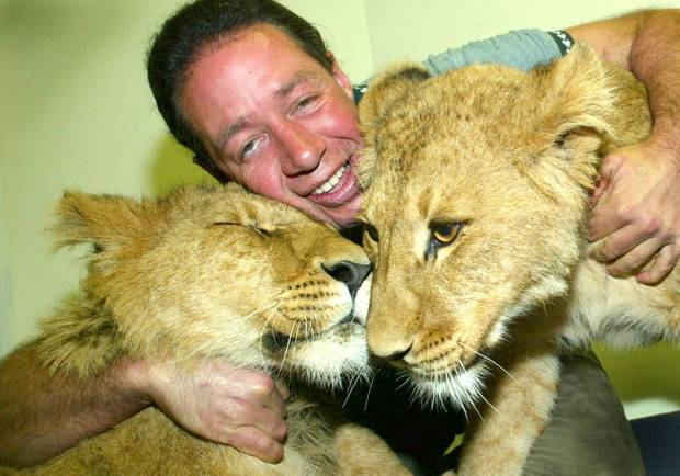 Lion cubs Aslan and Mardia with Craig Busch in 2003. Photograph / Northland Advocate
