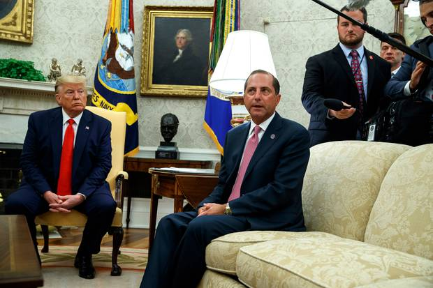 US President Donald Trump listens as Secretary of Health and Human Services Alex Azar talks about a plan to ban most flavoured e-cigarettes. Photo / AP