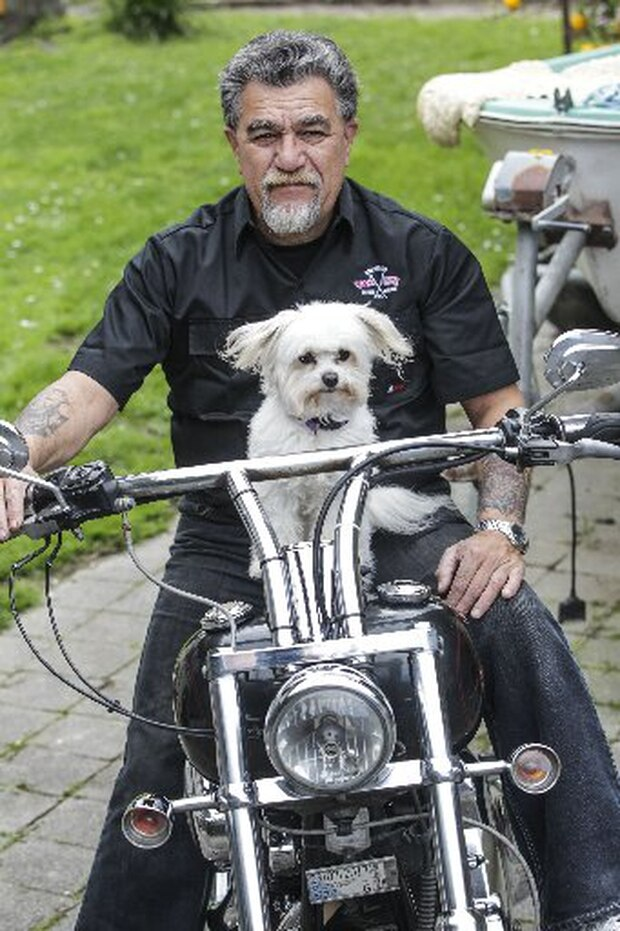 Napier motorcyclist Jason Wawatai and his dog Baxter. Baxter rides along on his Harley with him and they are part of a fundraising ride.