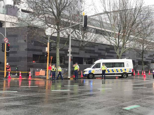 Police have cordoned off an area near the building in case another section of cladding falls. Photo / Will Trafford
