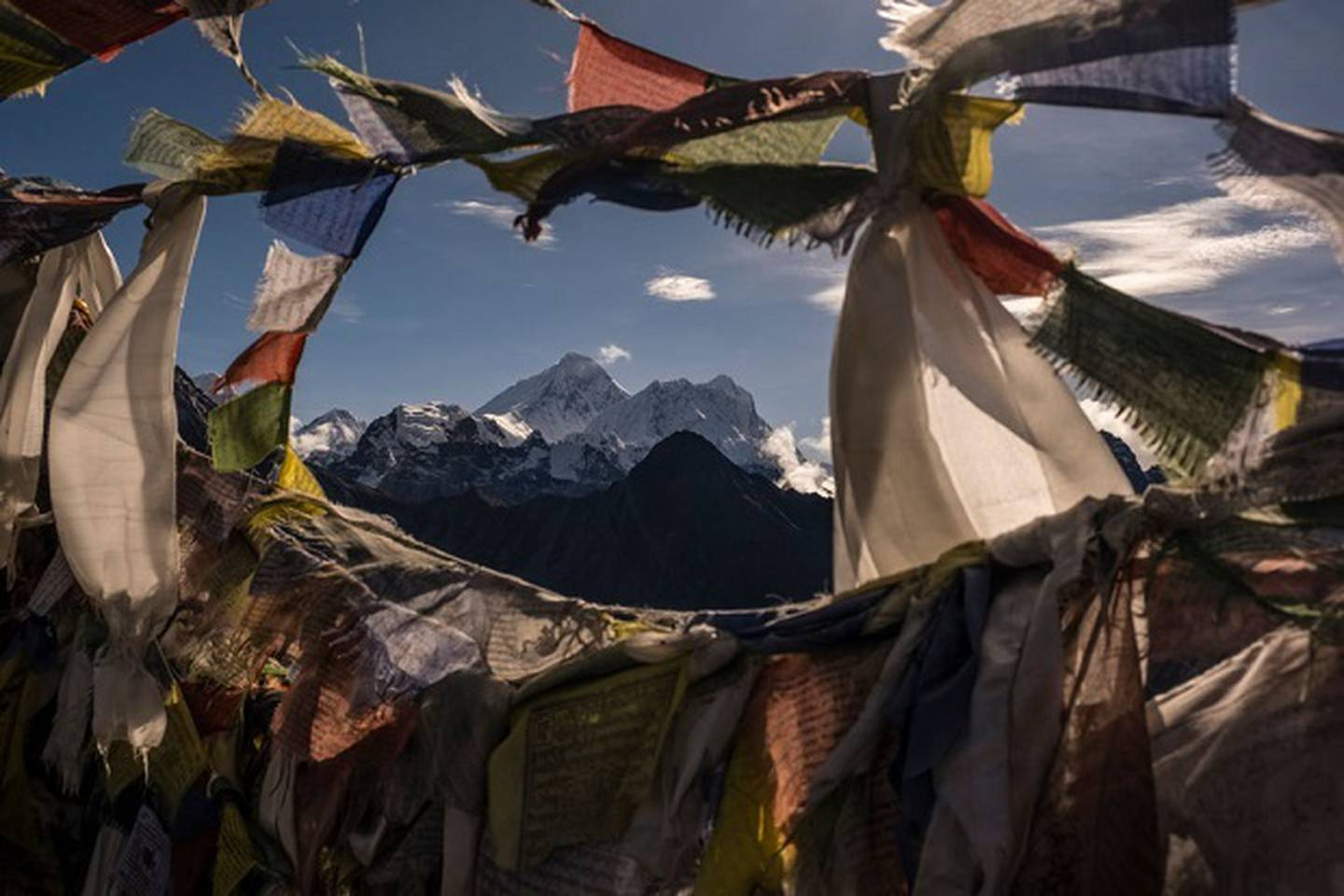 The summit of Mount Everest, seen through prayer flags from the summit of Gokyo Ri.  Photo / Getty Images