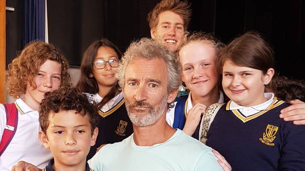 Actor Jed Brophy with students from Otaki College. Photo / Anna Groves