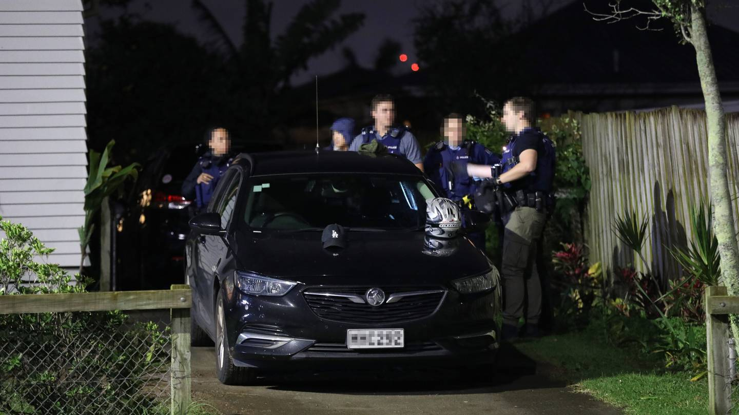 Armed police during a raid in Pt England, Auckland as part of Operation Trojan Shield. Photo / Hayden Woodward